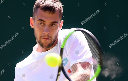 Stock Photo of Laslo Djere of Serbia in action against John Millman of Australia during their second round match at the Wimbledon Championships at the All England Lawn Tennis Club, in London, Britain, 04 July 2019.