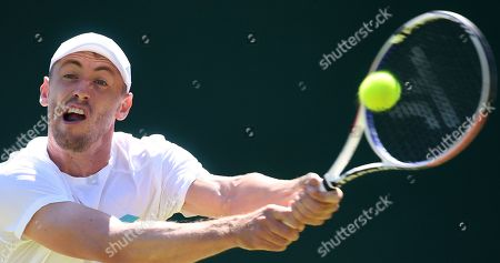 John Millman of Australia in action against Laslo Djere of Serbia during their second round match at the Wimbledon Championships at the All England Lawn Tennis Club, in London, Britain, 04 July 2019.