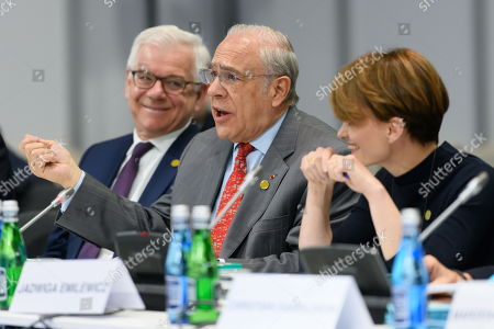 Polish Foreign Minister Jacek Czaputowicz (L), Jose Angel Gurria (C), secretary-general of the Organization for Economic Cooperation and Development (OECD) and Business and Technology Minister Jadwiga Emilewicz (R) during the talks at the summit of six Western Balkan countries taking part in the pre-accession Berlin Process started in the Polish western city of Poznan, Poland, 04 July 2019. The summit gathered officials from countries taking part in the Berlin Process, an initiative that supports the integration of the six Western Balkan nations with the European Union.