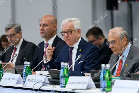 Polish Foreign Minister Jacek Czaputowicz (2R) and Jose Angel Gurria (R), secretary-general of the Organization for Economic Cooperation and Development (OECD) during the talks at the summit of six Western Balkan countries taking part in the pre-accession Berlin Process started in the Polish western city of Poznan, Poland, 04 July 2019. The summit gathered officials from countries taking part in the Berlin Process, an initiative that supports the integration of the six Western Balkan nations with the European Union.