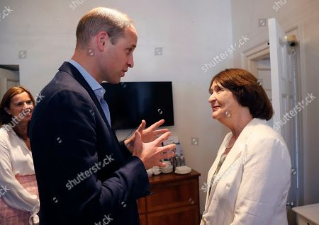 Stock Photo of Britain's Prince William, the Duke of Cambridge, President of The Royal Marsden NHS Foundation Trust, speaks to Pauline Gore the widow of cancer expert Martin Gore, during a visit to the Royal Marsden in Chelsea, London