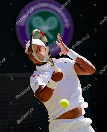 Jay Clarke of Britain returns to Roger Federer of Switzerland in their second round match during the Wimbledon Championships at the All England Lawn Tennis Club, in London, Britain, 04 July 2019.