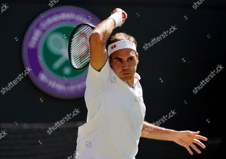 Roger Federer of Switzerland returns to Jay Clarke of Britain in their second round match during the Wimbledon Championships at the All England Lawn Tennis Club, in London, Britain, 04 July 2019.