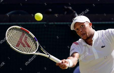 Stock Image of Jay Clarke of Britain returns to Roger Federer of Switzerland in their second round match during the Wimbledon Championships at the All England Lawn Tennis Club, in London, Britain, 04 July 2019.
