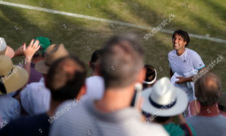 Marcos Baghdatis of Cyprus reacts with supporters after losing against Matteo Berrettini of Italy during their second round match at the Wimbledon Championships at the All England Lawn Tennis Club, in London, Britain, 04 July 2019. 34-year-old Baghdatis, who was the runner-up to Roger Federer at the Australian Open in 2006 and lost to Rafael Nadal in the semi final match in Wimbledon in 2006, retires after this tournament.