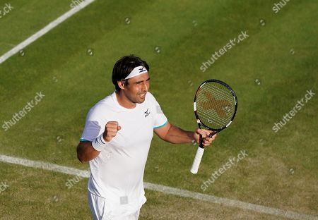 Marcos Baghdatis of Cyprus in action against Matteo Berrettini of Italy during their second round match at the Wimbledon Championships at the All England Lawn Tennis Club, in London, Britain, 04 July 2019. 34-year-old Baghdatis, who was the runner-up to Roger Federer at the Australian Open in 2006 and lost to Rafael Nadal in the semi final match in Wimbledon in 2006, retires after this tournament.