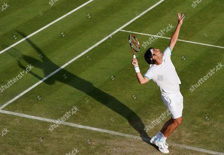 Stock Image of Marcos Baghdatis of Cyprus in action against Matteo Berrettini of Italy during their second round match at the Wimbledon Championships at the All England Lawn Tennis Club, in London, Britain, 04 July 2019. 34-year-old Baghdatis, who was the runner-up to Roger Federer at the Australian Open in 2006 and lost to Rafael Nadal in the semi final match in Wimbledon in 2006, retires after this tournament.