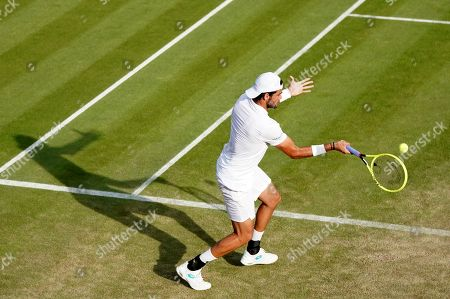Matteo Berrettini of Italy in action against Marcos Baghdatis of Cyprus during their second round match at the Wimbledon Championships at the All England Lawn Tennis Club, in London, Britain, 04 July 2019.