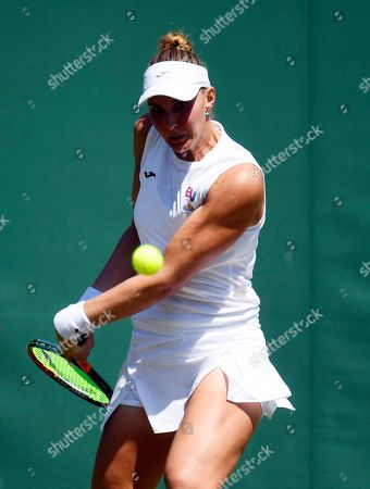Stock Picture of Beatriz Haddad Maia of Brazil returns to Harriet Dart of Britain in their second round match during the Wimbledon Championships at the All England Lawn Tennis Club, in London, Britain, 04 July 2019.