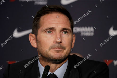 The new Chelsea manager their former player Frank Lampard poses for photographs with a club shirt at the start of his unveiling press conference at Stamford Bridge stadium in London, returning to Chelsea as the club's 12th manager in 16-years under Roman Abramovich's ownership. The former Chelsea midfielder has left second-tier club Derby, where he came close to securing promotion to the Premier League in his first season in management