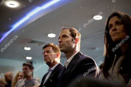 Former Chelsea goalkeeper Petr Cech who has recently been appointed as the club's Technical and Performance Advisor sits listening as their new manager and former player Frank Lampard speaks during his unveiling press conference at Stamford Bridge stadium in London, . Lampard has returned to Chelsea as the club's 12th manager in 16 years under Roman Abramovich's ownership. The former Chelsea midfielder has left second-tier club Derby, where he came close to securing promotion to the Premier League in his first season in management. Lampard, who is Chelsea's record scorer with 211 goals and one of its all-time greats, replaces Maurizio Sarri