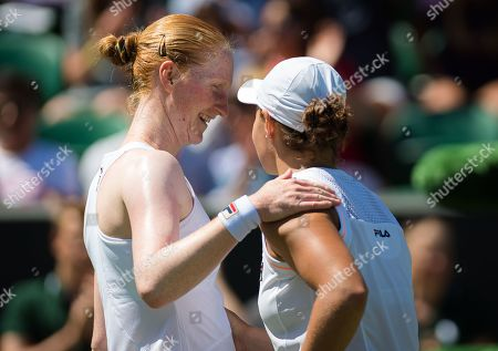 Alison Van Uytvanck of Belgium & Ashleigh Barty of Australia at the net after their second-round match