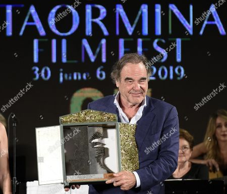 Oliver Stone receives the Angelo D'Arrigo Award during a ceremony at the Teatro Antico as part of the 65th annual Taormina Film Festival, in Taormina, Sicily Island, Italy, 04 July 2019. The festival runs from 30 June to 06 July.