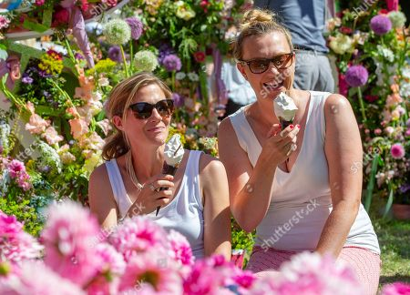 Friends Rachel Fenton and Helen Hill from Brighton, enjoying the scorching temperatures at The Hampton Court Flower Show.