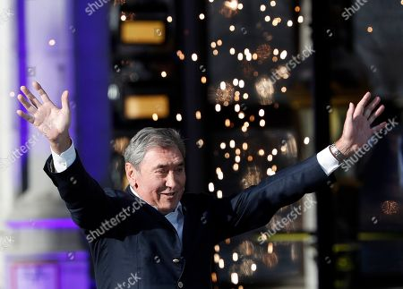 Former Belgian cycling champion Eddy Merckx waves during the Tour de France cycling race teams presentation at the Grand Place in Brussels, ahead of upcoming Saturday's start of the race
