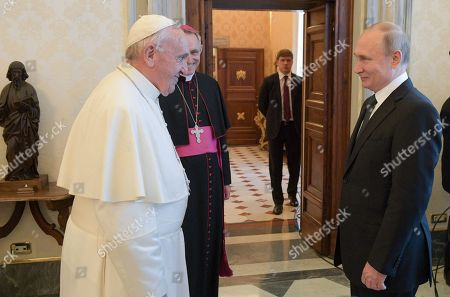 Pope Francis (L) and Russian President Vladimir Putin (R) smile as Archbishop Georg Ganswein (2-L) looks on during their meeting at the Vatican, 04 July 2019. Putin arrived for a one-day visit to Vatican and Rome to meet with the Pope and Italian leaders.