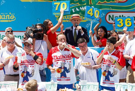 Competitive eaters George Chiger (L), Joey Chestnut (C) and Matt Stonie (R) compete in the Nathan's Famous Fourth of July International Hog Dog Eating contest in Coney island in Brooklyn, New York, USA, 04 July 2019. Chestnut won the event for the twelfth time, eating 71 hot dogs.