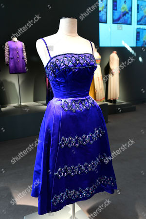 A satin blue cocktail dress with embroidery from the wardrobe of Italian actress Claudia Cardinale is on display at Sotheby's auction house in Paris, France, 04 July 2019. Some 130 couture and ready-to-wear creations will go on sale in a public online auction, titled 'Claudia Cardinale: Dressing a Star', at Sotheby's on 09 July 2019.