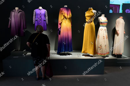 A visitor stands in front of a Balestra dress (C, 1972) from the wardrobe of Italian actress Claudia Cardinale, on display at Sotheby's auction house in Paris, France, 04 July 2019. Some 130 couture and ready-to-wear creations will go on sale in a public online auction, titled 'Claudia Cardinale: Dressing a Star', at Sotheby's on 09 July 2019.