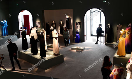 Visitors walk by dresses from the wardrobe of Italian actress Claudia Cardinale on display at Sotheby's auction house in Paris, France, 04 July 2019. Some 130 couture and ready-to-wear creations will go on sale in a public online auction, titled 'Claudia Cardinale: Dressing a Star', at Sotheby's on 09 July 2019.