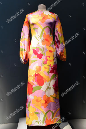 Stock Image of A long printed crepe dress from the wardrobe of Italian actress Claudia Cardinale is on display at Sotheby's auction house in Paris, France, 04 July 2019. Some 130 couture and ready-to-wear creations will go on sale in a public online auction, titled 'Claudia Cardinale: Dressing a Star', at Sotheby's on 09 July 2019.