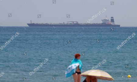 The oil tanker 'Grace 1' is seen near the coast of La Linea de la Concepcion, Cadiz, southern Spain, 04 July 2019, after it was seized by Gibraltar authorities and British Royal Marines in a joint operation in Gibraltar. The vessel is suspected of delivering Iranian oil to Syrian Banyas refinery in violation of EU sanctions, the territory's Chief Minister Fabian Picardo said in a statement.