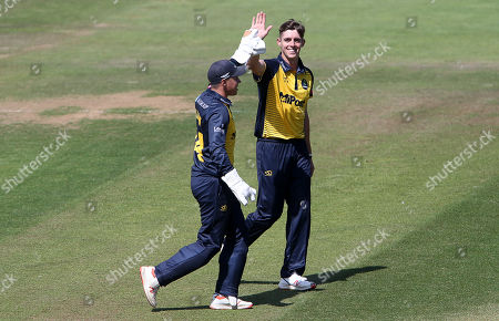 Roman Walker celebrates with Tom Cullen of Glamorgan.