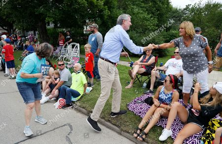 Stock Picture of Democratic presidential candidate New York Mayor Bill DeBlasio greets local residents while walking in the Independence Fourth of July parade, in Independence, Iowa