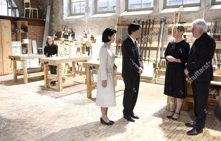 Nikari CEO Johanna Vuorio (2R) and Nikari founder Kari Virtanen (R) welcome Crown Prince Akishino (2L) and Crown Princess Kiko (L) of Japan at the workshop of Nikari, a wood design studio and furniture manufacturer, in the Fiskars Village in Raasepori