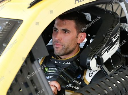 Aric Almirola prepares to go out on the track during a NASCAR auto race practice at Daytona International Speedway, in Daytona Beach, Fla