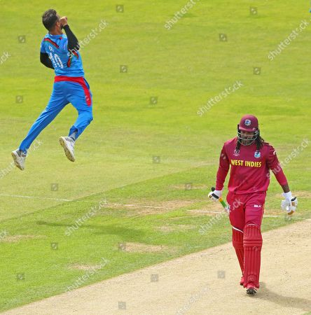 LEEDS, ENGLAND. 04 JULY Chris Gayle of West Indies walks off after being dismissed as Dawlat Zadran of Afghanistan celebrates taking the wicket during the Afghanistan v West Indies, ICC Cricket World Cup match, at Headingley, Leeds, England