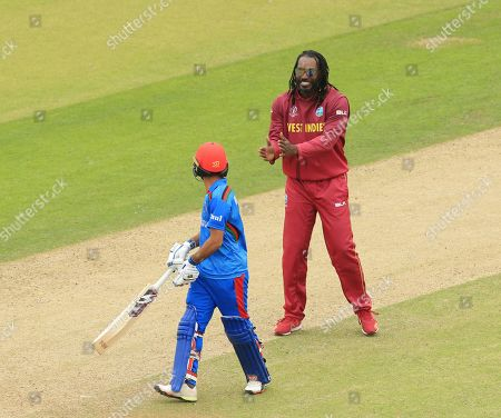LEEDS, ENGLAND. 04 JULY Chris Gayle of West Indies applauds Ikram Ali Khil of Afghanistan after taking his wicket during the Afghanistan v West Indies, ICC Cricket World Cup match, at Headingley, Leeds, England