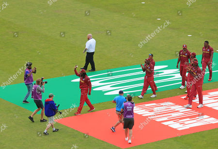 LEEDS, ENGLAND. 04 JULY Chris Gayle of West Indies walks off the pitch for the last time at a World Cup during the Afghanistan v West Indies, ICC Cricket World Cup match, at Headingley, Leeds, England