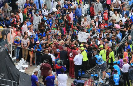 Stock Picture of LEEDS, ENGLAND. 04 JULY Chris Gayle of West Indies signs autographs for fans during the Afghanistan v West Indies, ICC Cricket World Cup match, at Headingley, Leeds, England
