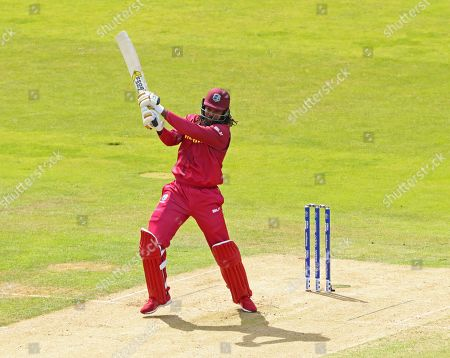 LEEDS, ENGLAND. 04 JULY Chris Gayle of West Indies hits the ball for four runs during the Afghanistan v West Indies, ICC Cricket World Cup match, at Headingley, Leeds, England