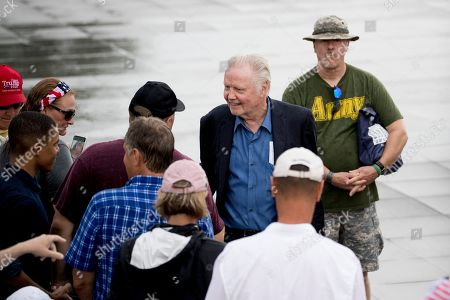 Actor Jon Voight greets visitors before President Donald Trump's Independence Day celebration in front of the Lincoln Memorial, in Washington
