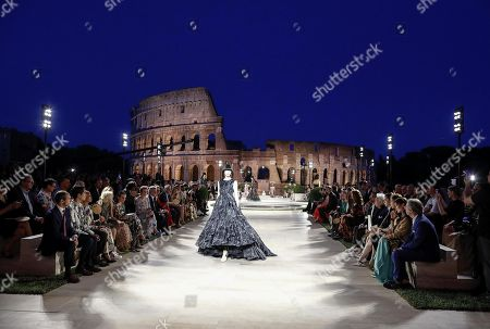Italian model Mariacarla Boscono presents a creation during a fashion show of Italian luxury fashion house Fendi held in tribute of its former creative director, the late German fashion designer Karl Lagerfeld, at the Temple of Venus on the Palatine Hill in Rome, Italy, 04 July 2019. Lagerfeld was at the maison's helm for 54 years until his death in February 2019.