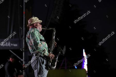 Stock Image of British saxophone player Lee Thompson of British band Madness performs on stage during their concert in Madrid, Spain, 04 July 2019.