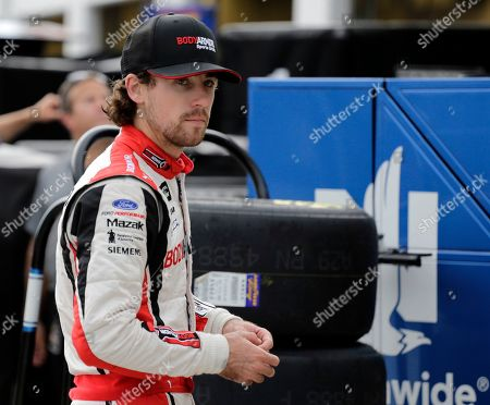 Ryan Blaney walks to his garage during a NASCAR auto race practice at Daytona International Speedway, in Daytona Beach, Fla