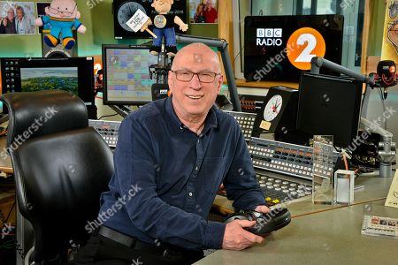 Stock Photo of Ken Bruce in studio