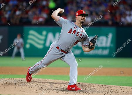 Los Angeles Angels relief pitcher Taylor Cole throws to a Texas Rangers batter during the fourth inning of a baseball game in Arlington, Texas