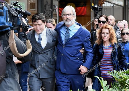 Australian actor John Jarratt (C) and wife Rosa Miano (R) leave the Downing Centre Court in Sydney, Australia, 05 July 2019. Jarratt was in court for an alleged rape in 1976. The actor has pleaded not guilty.