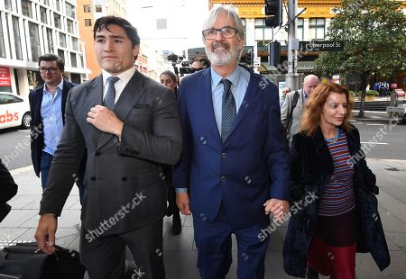 Stock Image of Australian actor John Jarratt (C) and wife Rosa Miano (R) leave the Downing Centre Court in Sydney, Australia, 05 July 2019. Jarratt was in court for an alleged rape in 1976. The actor has pleaded not guilty.