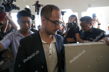 Riza Aziz, stepson of Malaysian former Prime Minister Najib Razak, walks into a court room at Kuala Lumpur High Court in Kuala Lumpur, Malaysia, . Malaysia's anti-graft agency said Thursday it has detained Riza Aziz, the stepson of ex-premier Najib Razak and a Hollywood film producer, and will charge him with money laundering