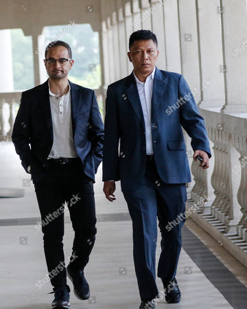 Riza Aziz (L), stepson of the former Malaysian Prime Minister Najib Razak, arrives at the Kuala Lumpur High Court in Kuala Lumpur, Malaysia, 05 July 2019. Riza Aziz, the Hollywood film producer of 'Wolf of Wall Street', is to face money laundering charges linked to 1Malaysia Development Berhad (1MDB).