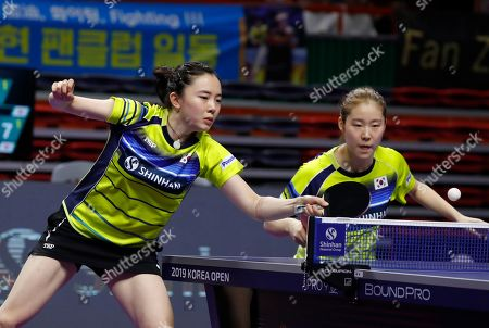 Stock Image of Jeon Ji-hee (L) and Lee Zi-on of South Korea in action during the women's doubles table tennis semifinals match against Yang Hae-un and Choi Hyo-joo of South Korea at the Seamaster 2019 International Table Tennis Federation (ITTF) World Tour Shinhan Korea Open at Sajik Gym in Busan, South Korea, 05 July 2019.