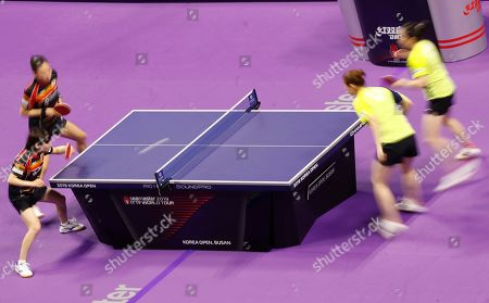 Stock Image of Choi Hyo-joo (L) and Yang Hae-un (2-L) of South Korea in action during the women's doubles table tennis semifinals match against Jeon Ji-hee and Lee Zi-on of South Korea at the Seamaster 2019 International Table Tennis Federation (ITTF) World Tour Shinhan Korea Open at Sajik Gym in Busan, South Korea, 05 July 2019.