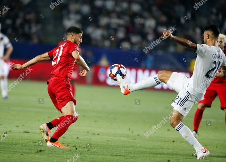LA Galaxy defender Giancarlo Gonzalez (21) and Toronto FC midfielder Jonathan Osorio (21) vie for the ball during an MLS soccer match in Carson, Calif., . The Galaxy won 2-0