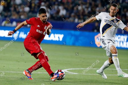 Stock Picture of Toronto FC midfielder Marky Delgado (8) controls the ball against LA Galaxy defender Daniel Steres (5) during an MLS soccer match in Carson, Calif., . The Galaxy won 2-0