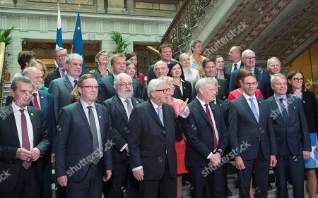 European Comission President Jean-Claude Juncker (C), Finnish Prime Minister Antti Rinne (C-R), with EU Commissioner Jyrki Katainen (3-R, front) pose for a family photo at the House of the Estates (Saaty) in Helsinki, Finland, 05 July 2019. Finland started its EU Council Presidency period on 01 July 2019. The presidency rotates among the EU member states every six months.